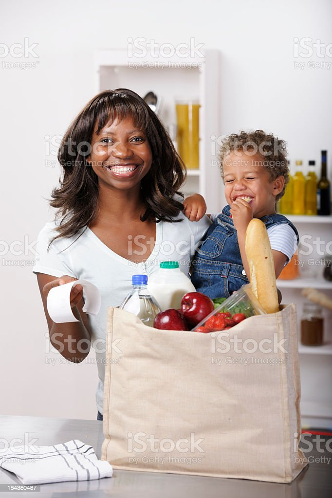 African American Woman And Toddler Celebrating Grocery Shopping Savings. royalty-free stock photo