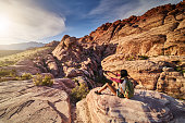 african american woman at red rock canyon taking selfie on ledge with lens flare