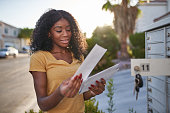 african american woman checking mail in las vegas community during the day