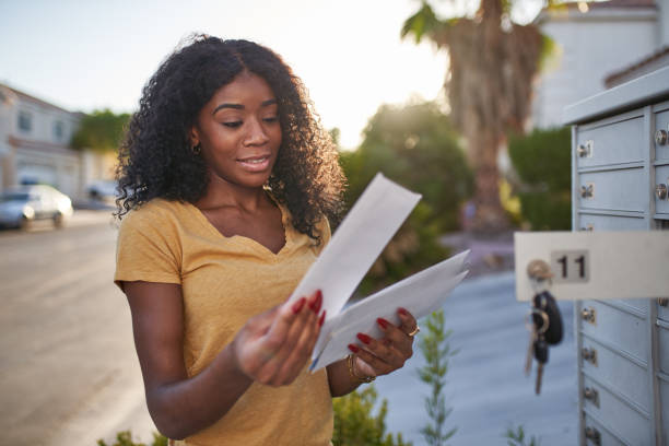 african american woman checking mail in las vegas community stock photo