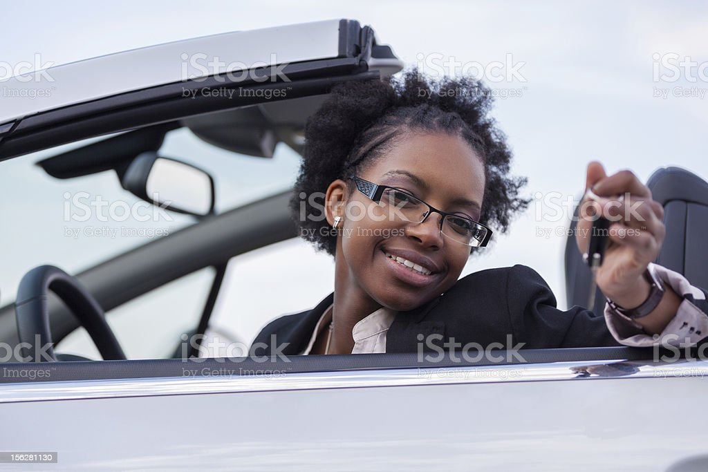 African american woman driver holding car keys royalty-free stock photo