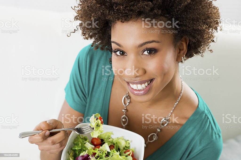 African American Woman Eating Salad royalty-free stock photo
