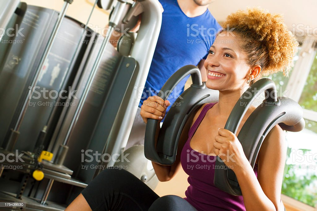 African American Woman exercise in a gym. stock photo