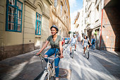 African American woman exploring Budapest on bicycles with her two friends