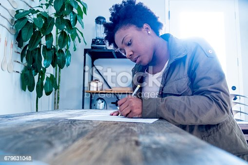 istock African American Woman Fills out Form 679631048