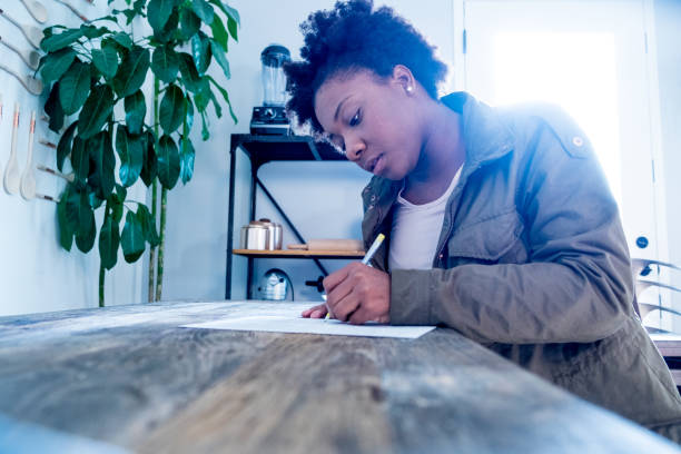 african american woman fills out form - job search stock photos and pictures