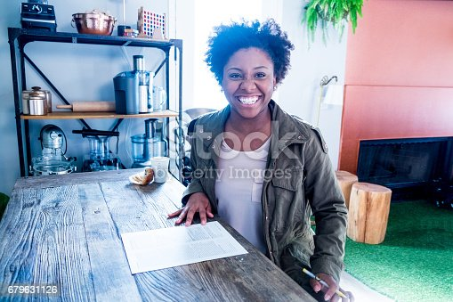 istock African American Woman Fills out Form 679631126