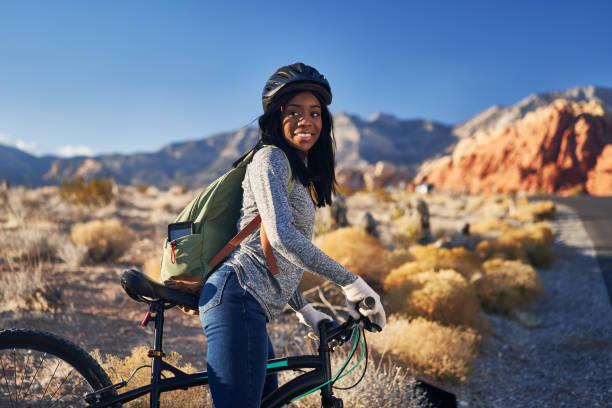 african american woman getting ready to begin bike ride stock photo