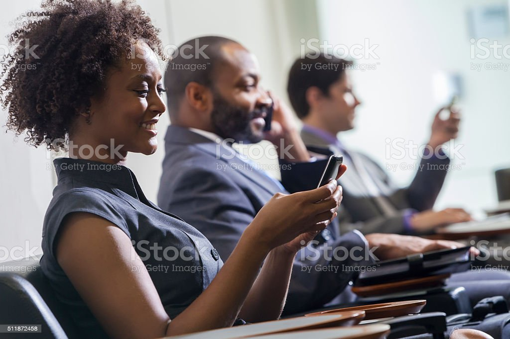 African American Woman Girl Texting on Cell Phone Airport stock photo