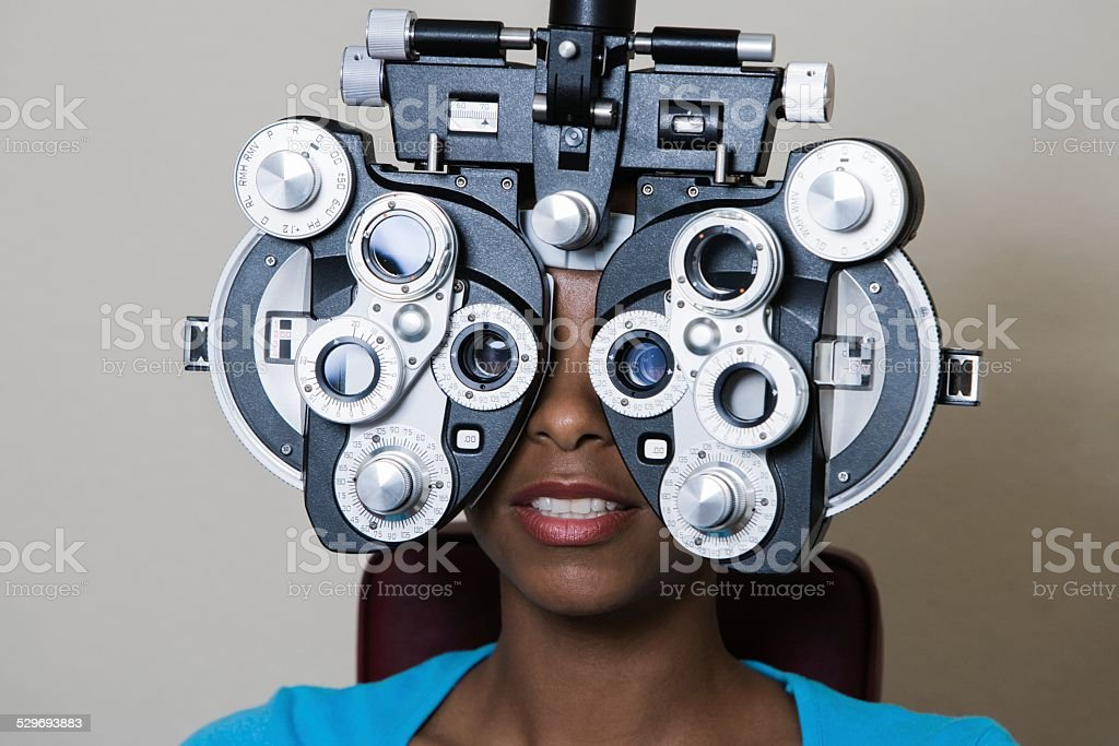 African American woman having her vision checked stock photo