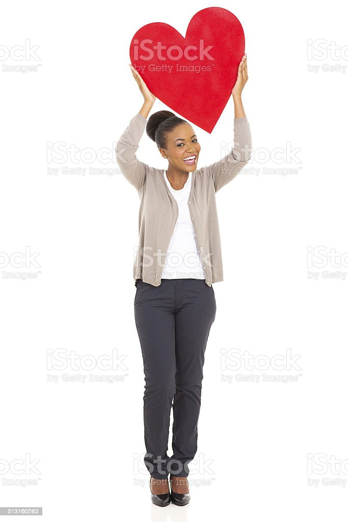 african american woman holding heart shape stock photo