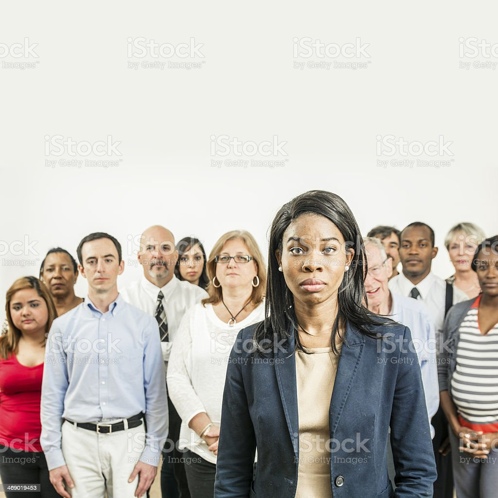 African American woman in front of group of people royalty-free stock photo