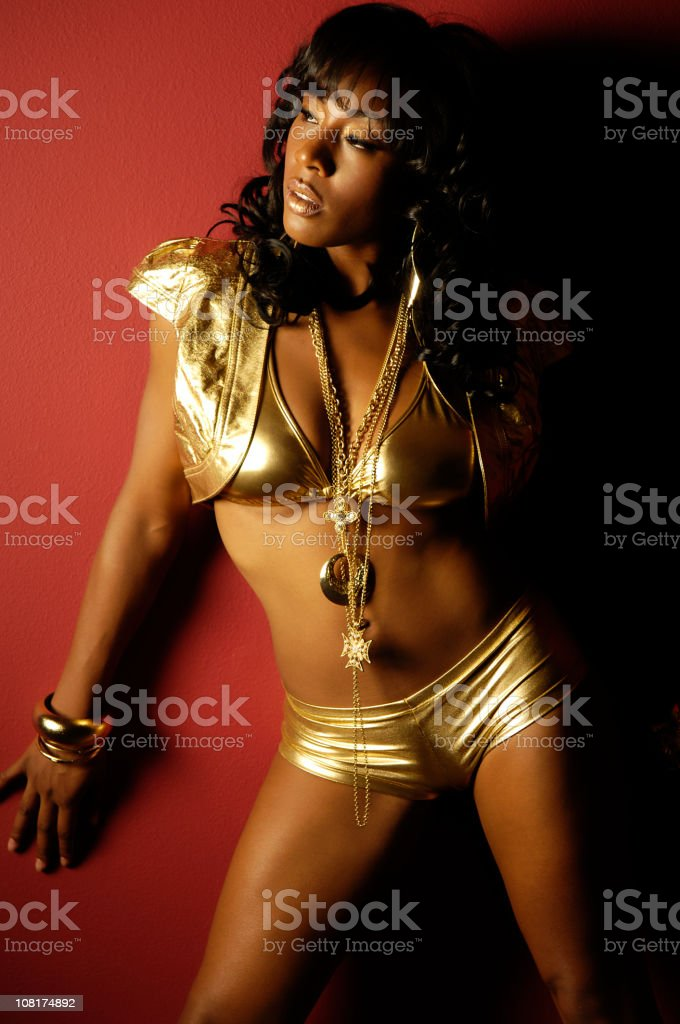 African American Woman in Gold Hip Hop outfit royalty-free stock photo