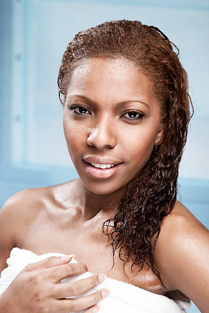African American Woman in Shower stock photo