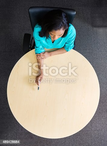 istock African American woman is businesswoman or student, working at table 489428684