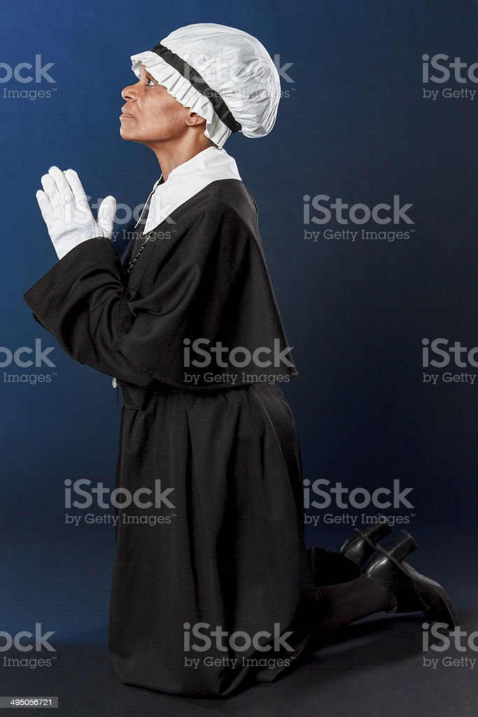 African American Woman Kneeling In Prayer stock photo