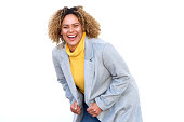 istock african american woman laughing with jacket against isolated white background 1137796437