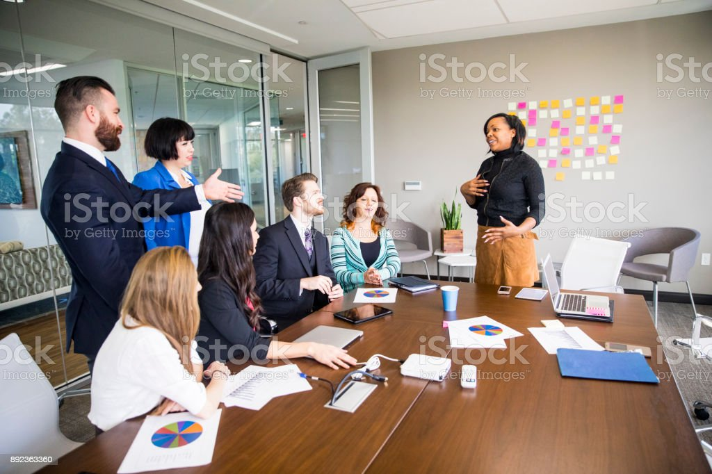 African American Woman Leads Business Team Meeting in the Conference Room stock photo