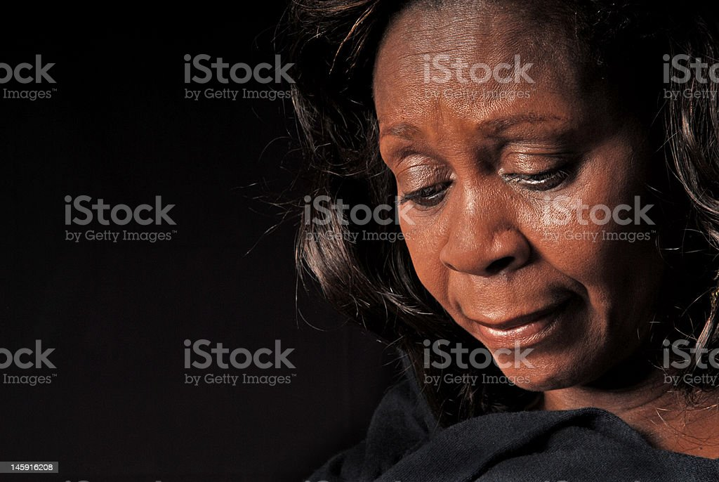 African American Woman Looking Down stock photo