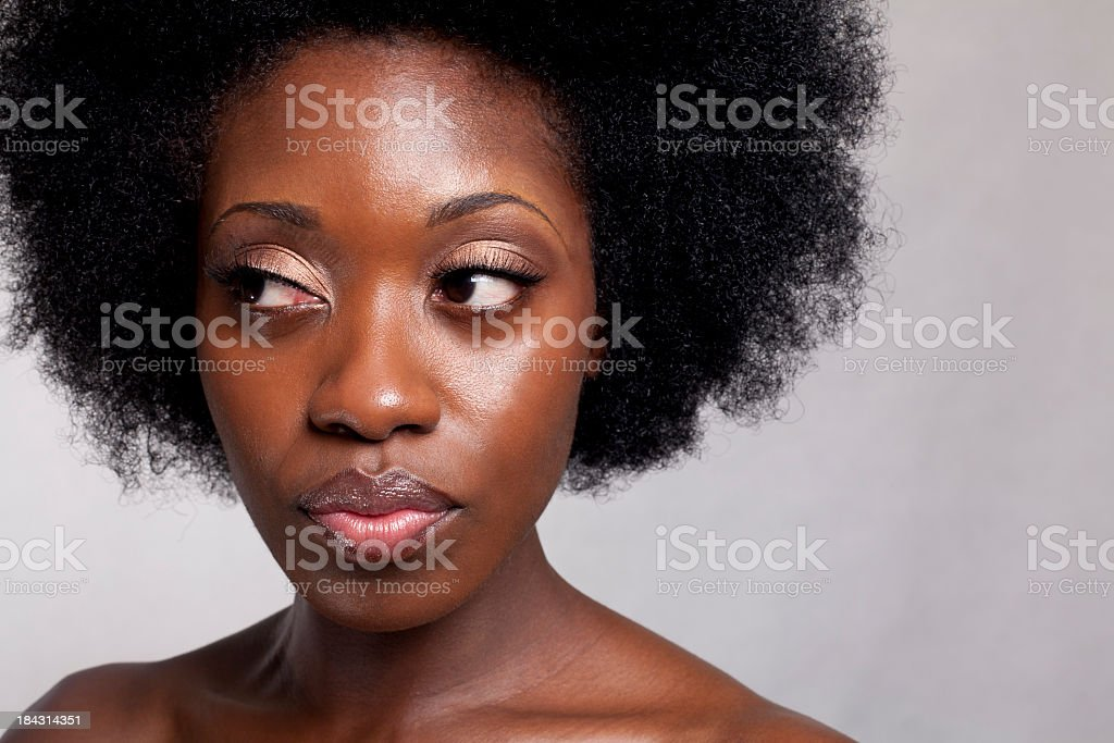 African American woman looking in a different direction stock photo