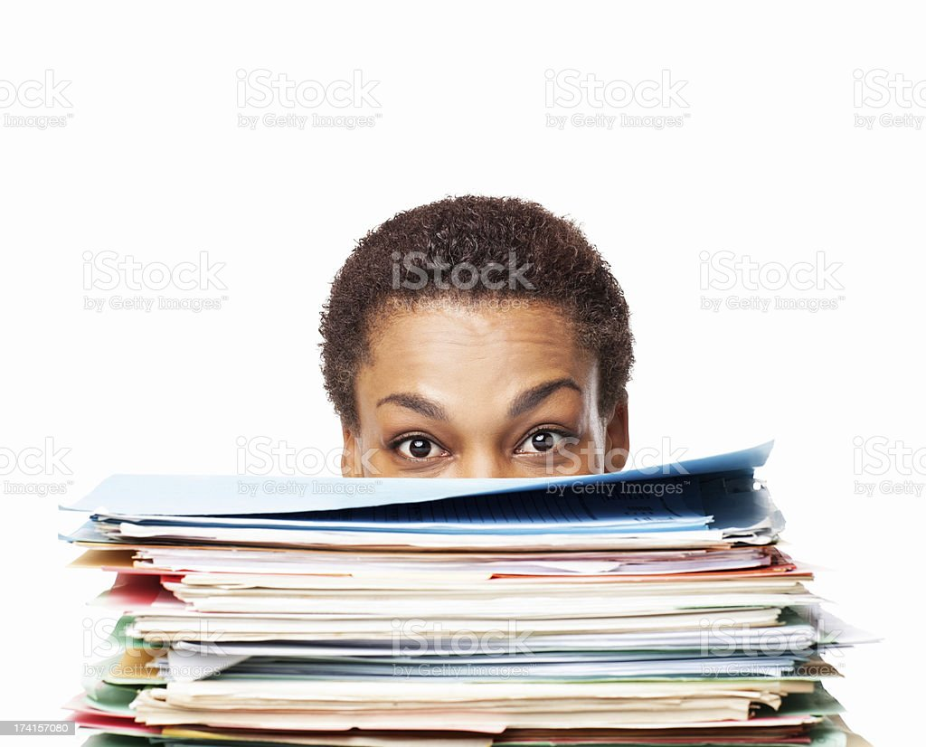 African American Woman Looking Over Work Files - Isolated royalty-free stock photo