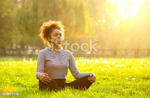 istock African american woman meditating in nature 478811176