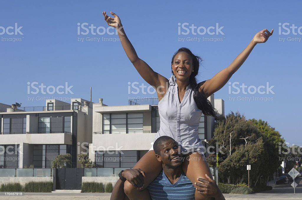 African American woman on the shoulders of a friend royalty-free stock photo