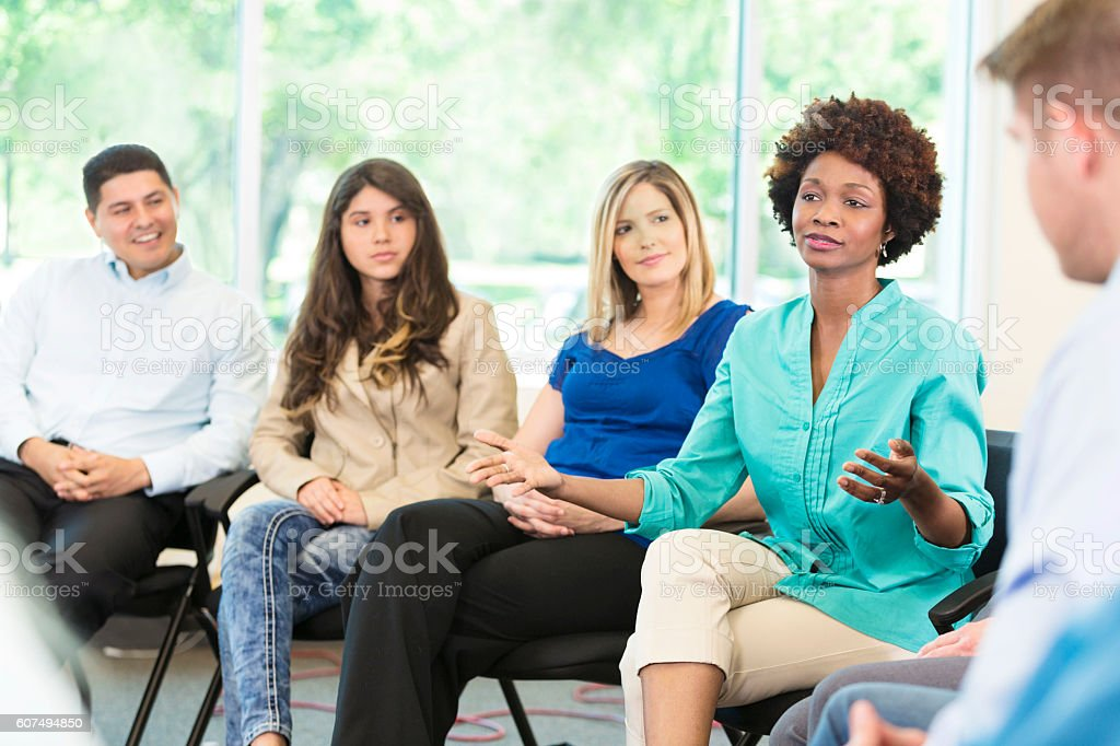 African American woman participates in group therapy stock photo