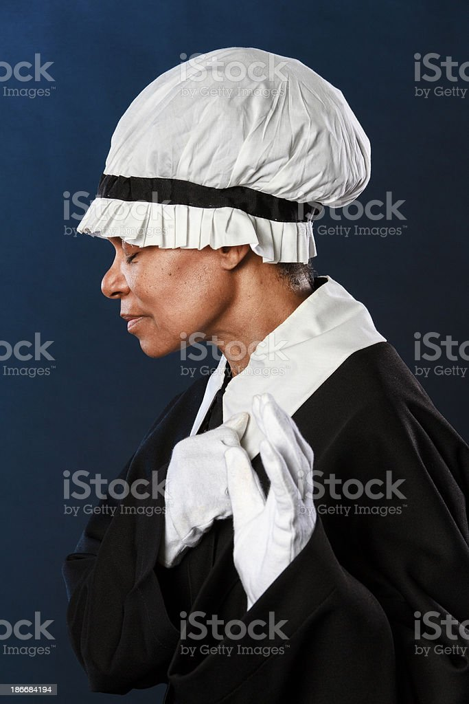 African American Woman Praying With Hand Raised stock photo