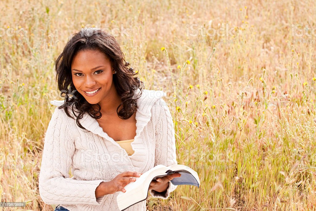 African American woman reading royalty-free stock photo