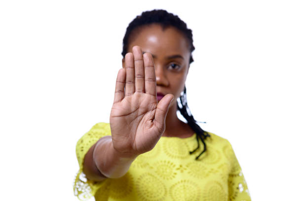 African American woman showing hand stop gesture stock photo