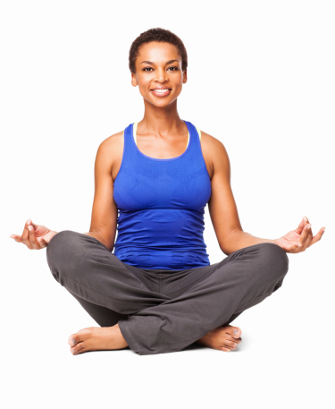 african american woman sitting in lotus position isolated