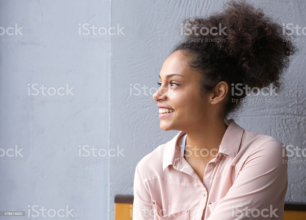 African american woman smiling and looking away stock photo
