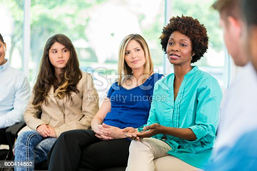 istock African American woman speaking during group therapy 600414852
