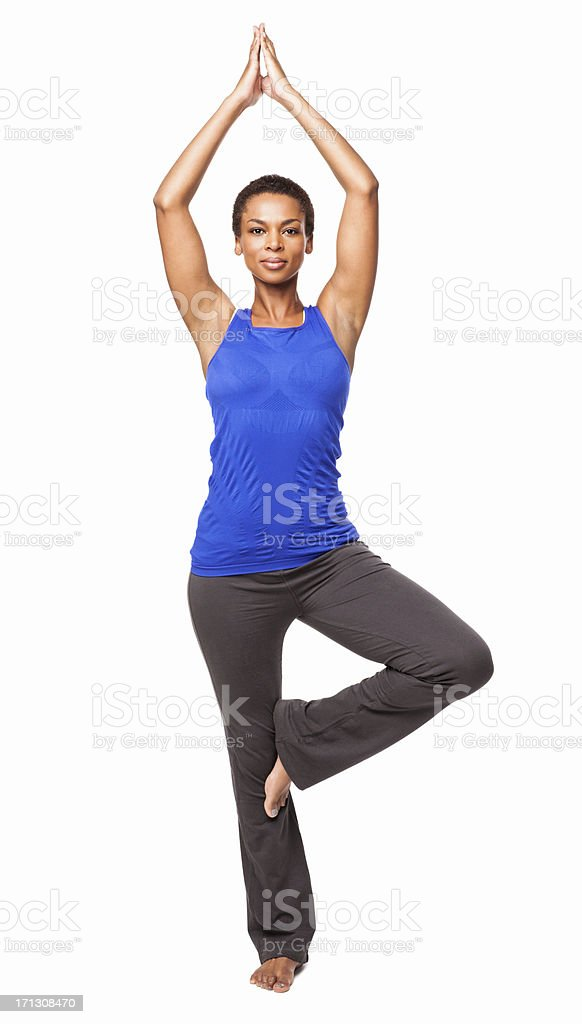 African American Woman Standing In a Yoga Position - Isolated stock photo