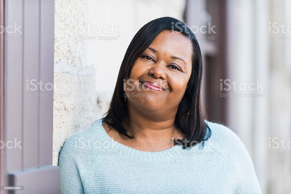 African American woman standing outdoors stock photo
