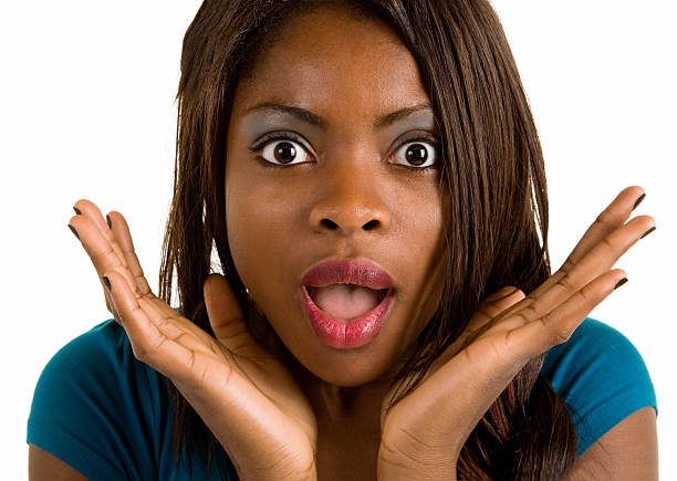 African American Woman Surprised about Something An African American woman is surprised about something. dazzled stock pictures, royalty-free photos & images