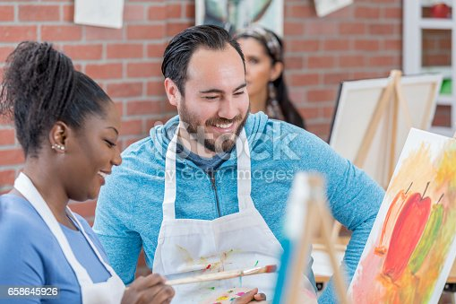 658645980 istock photo African American woman takes an art class 658645926