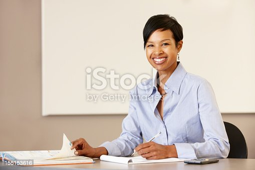 istock African American woman teaching working at desk 155153616