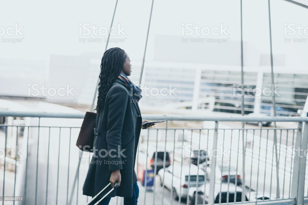African American woman traveling solo at the airport stock photo
