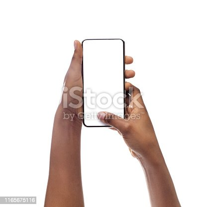 614011750istockphoto African American Woman Using Cellphone With Empty Screen, Closeup 1165675116