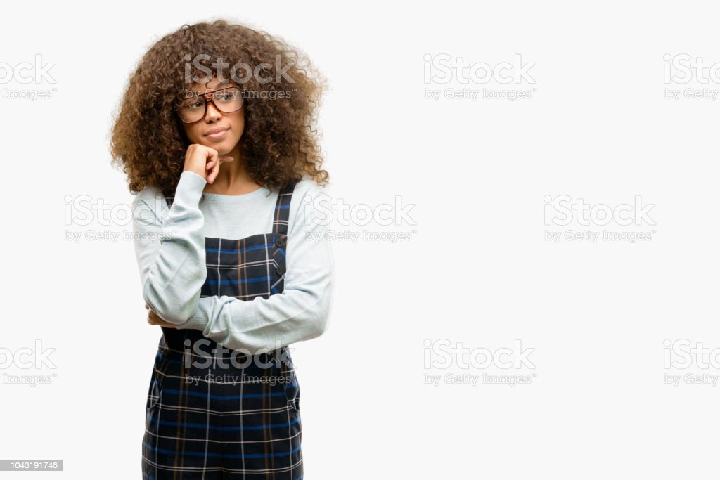 African american woman wearing a retro style serious face thinking about question, very confused idea stock photo