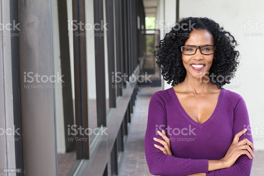 African american woman wearing glasses at work A pretty African american woman wearing glasses at work. 40-49 Years Stock Photo