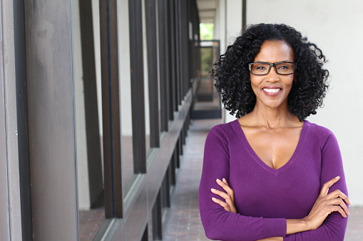 African American Woman Wearing Glasses At Work Stock Photo - Download Image Now