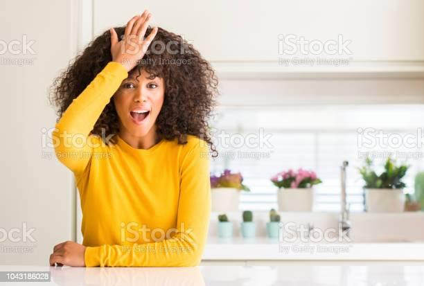 African american woman wearing yellow sweater at kitchen surprised picture id1043186028?b=1&k=6&m=1043186028&s=612x612&h=cv6jvsa2w5avsvemlojlkzu hpn0oriu3hpujmj29cc=