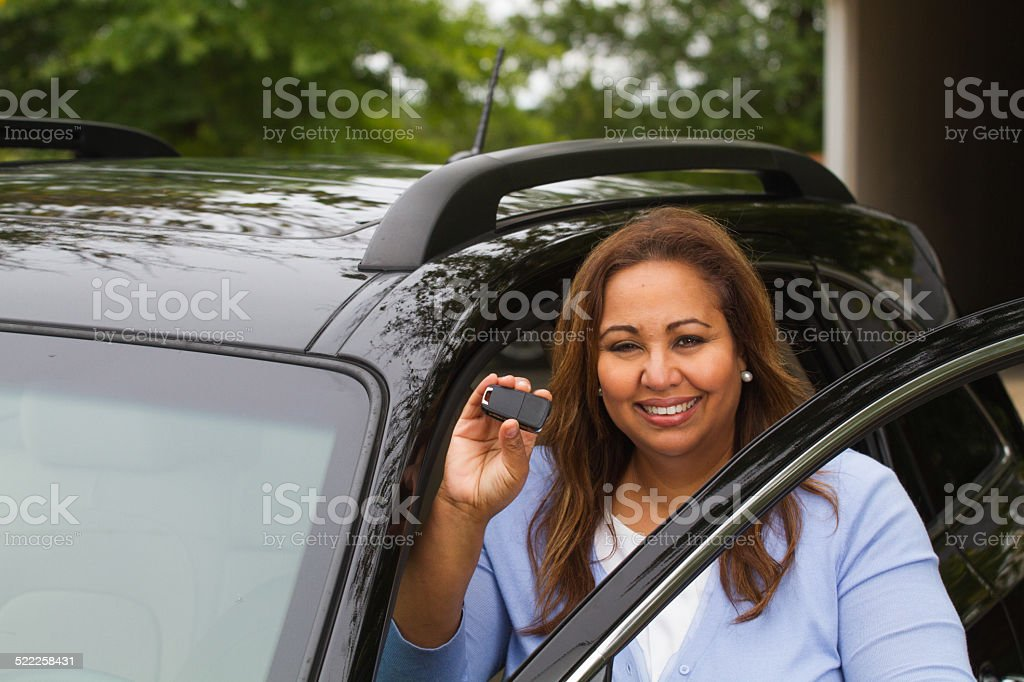 African American woman with a new car stock photo