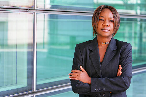 African american woman with arms folded stock photo