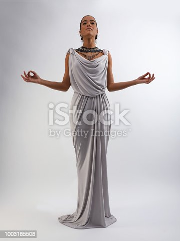 African American woman with bow and arrow wearing Grecian style dress