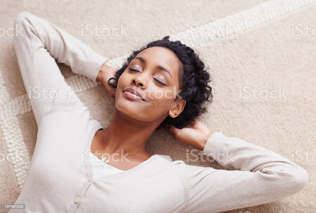 African American woman with her eyes closed relaxing stock photo