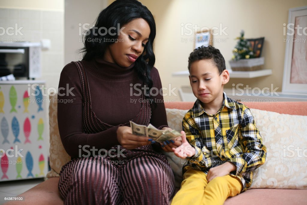 African American woman with her son. stock photo